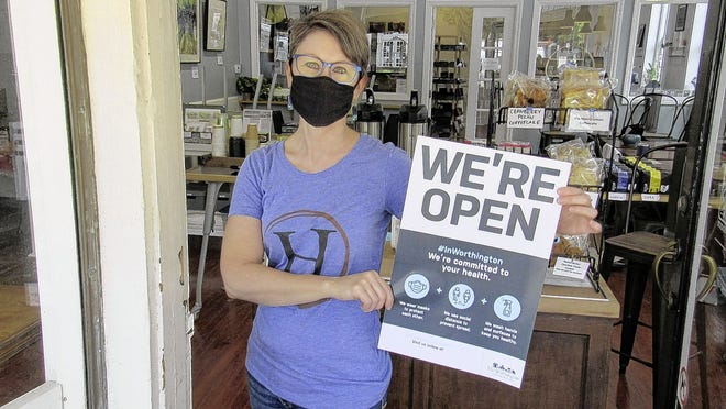 """Christie Bruffy of Highline Coffee Co. has reopened her business at 691 High St. in downtown Worthington. Bruffy is participating in the """"We're Open"""" campaign launched by the Worthington Responsible Business Opening & Operations Team, or ReBOOT, in which the city and partner agencies are helping market restaurants and small businesses."""