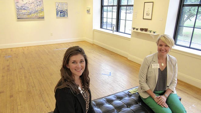"Kati Serbu (left) and Erin Blue sit in the gallery of the Peggy R. McConnell Arts Center of Worthington, 777 Evening St. in Worthington, which opened June 23 on a limited basis with the juried ""Virtual MAC Faculty Show."" Serbu is director of programming and engagement for the MAC and Blue is the center's executive director."