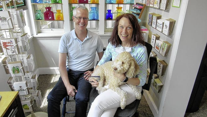 Brother and sister John and Julie Jenkins, who is holding Maddie, recently purchased Helen Winnemore's, an artisan craft store at 150 E. Kossuth St. in German Village. Julie Jenkins recently closed her Fresh Crafts Gallery, 2068 Arlington Ave. in Upper Arlington, so she could focus on the German Village store.