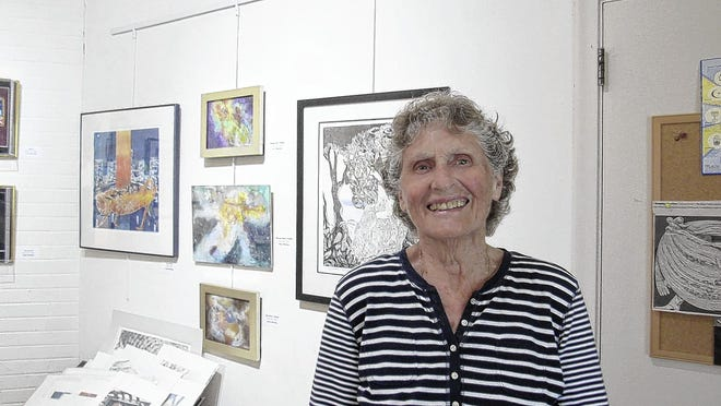 Carol Hershey stands in her studio at High Road Studio & Galleries, 12 E. Stafford St., in Worthington. Hershey has opened her first exhibit in High Road, which she purchased 20 years ago.