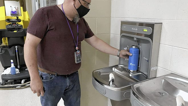 Eric Steinle, head custodian at Pickerington Schools' Toll Gate Elementary and Middle School campus, tests a new touchless water-bottle filling station July 14 at Toll Gate Elementary. The district has installed numerous stations at each school building and has deactivated other water fountains to avoid frequent touch points that could contribute to the spread of COVID-19.