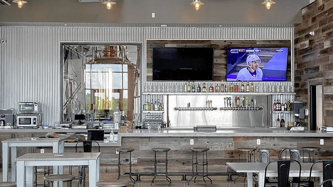 Modern indoor seating and a bank of flat-screen televisions are featured in the bar area of the new Edison Brewing Co., 785 Science Blvd. in Gahanna.