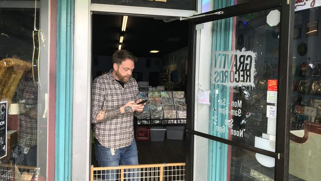 Gravity Records owner Matt Keen took orders from inside his Castle Street shop on March 18. Gravity recently re-opened to customers after being closed for nearly six months.