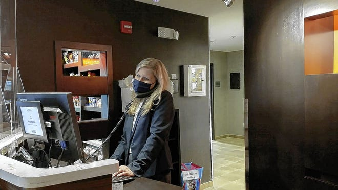 Courtyard by Marriott Columbus New Albany general manager Kelley Foster answers a phone Sept. 10. Managers of area hotels said the COVID-19 coronavirus pandemic has taken its toll, but business is trending upward.