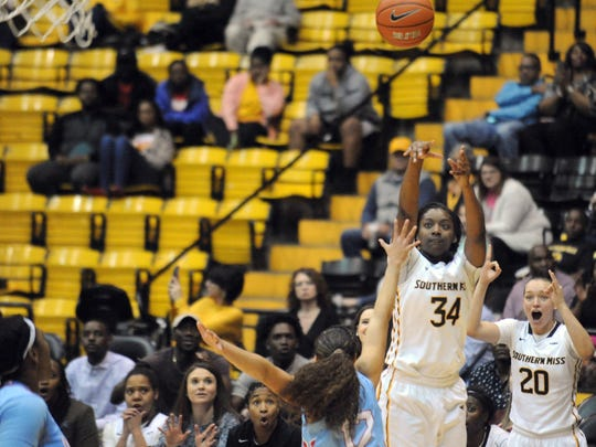 Southern Miss freshman Respect Leaphart attempts a three-pointer during a recent home game.