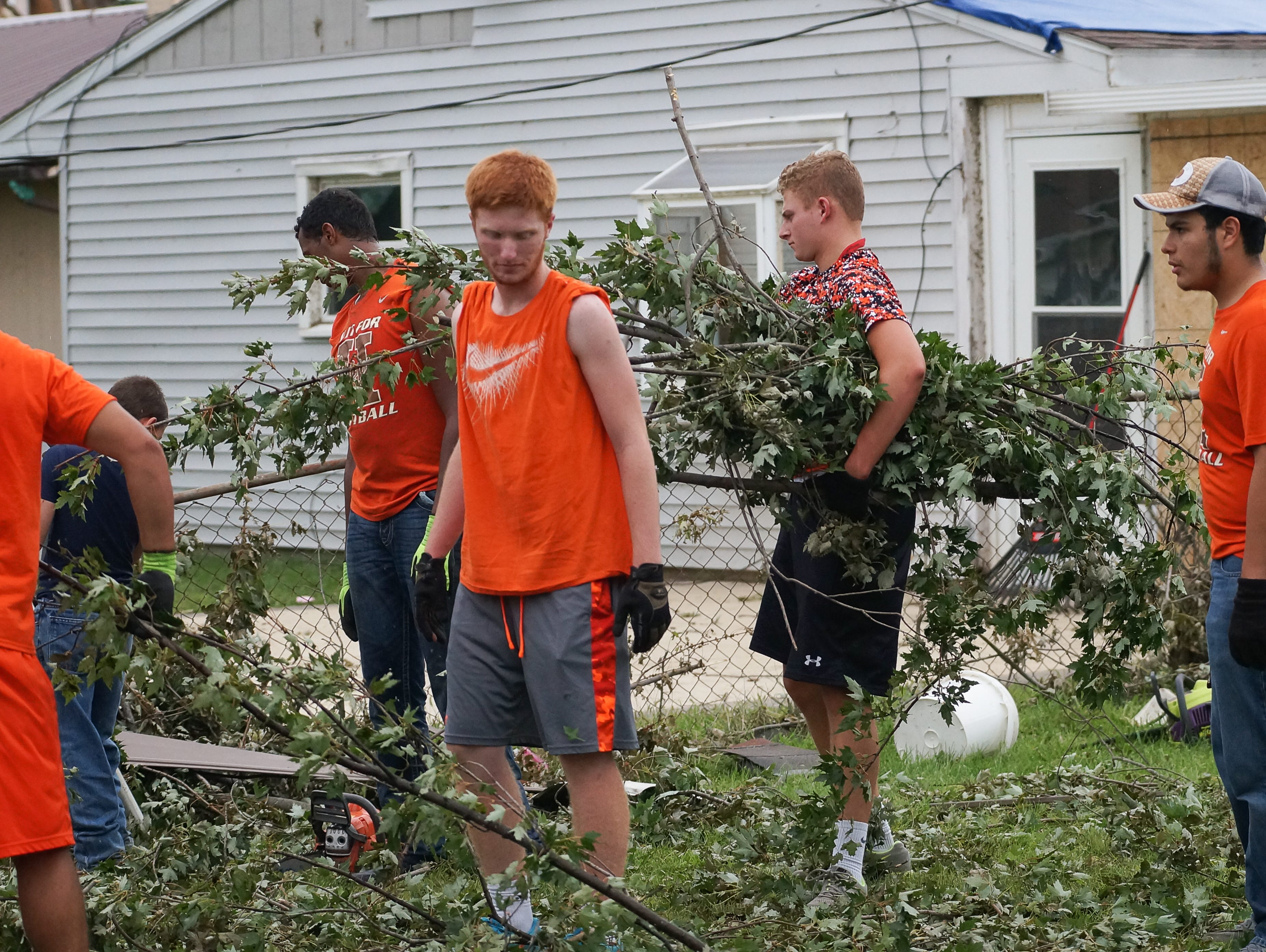 From left to right: Hamilton Heights football players Braydon Denham, Tyson Maylone, Tristian Kinnaman, Camden Dimmock and Steven Zamora helped out with cleanup in Kokomo following last week's tornadoes.