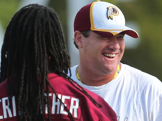 The Washington Redskins' head coach Jay Gruden, right), talks with Brandon Meriweather during the Redskins' morning practice at the Bon Secours Washington Redskins Training Center Monday, Aug. 11, 2014, in Richmond, Va. (AP Photo/Richmond Times-Dispatch, P. Kevin Morley )