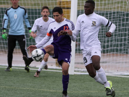 Eastlake's Salvador Silva (12) tries to keep possession