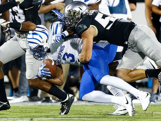 Memphis receiver Anthony Miller (left) is tackled by