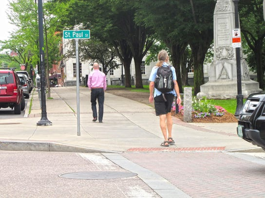 Michael Healy walks to an appointment in downtown Burlington