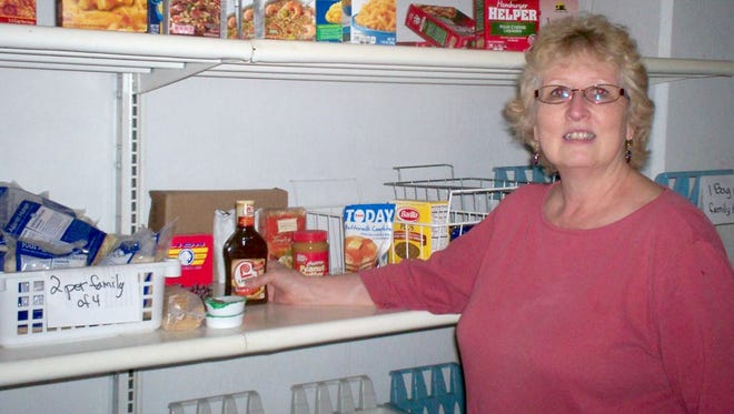 Pictured in St. Nazianz Christian Thrift Store Pantry is Ministry Board member Kris Antolec.