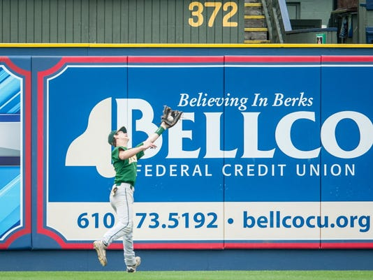 York Catholic left fielder Jake Krevetski (11) makes a catch near the wall against Lancaster County Christian in the PIAA District 3 Class A title game at First Energy Stadium in Reading on Thursday, May 29, 2014. Jeff Lautenberger -- GameTimePA.com