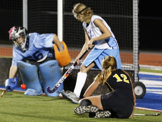Red Lion's Morgan Kuehne, right, attempts a goal against Dallastown goalkeeper Niki Bream, left, during overtime of last year's YAIAA field hockey tournament championship. (GAMETIMEPA.COM -- FILE)