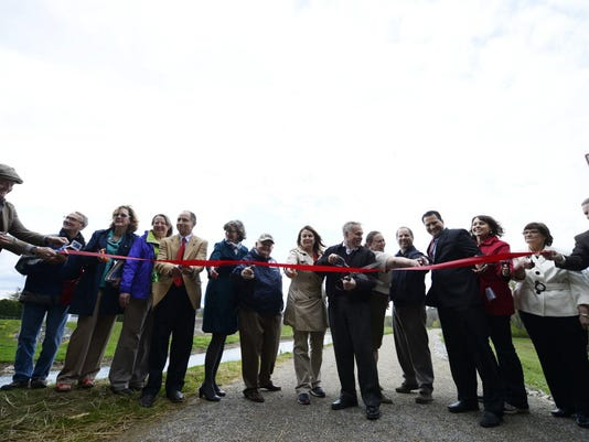 The ribbon is cut on the day of the official opening of a new section of the Heritage Rail Trail County Park in Springettsbury Township Wednesday, April 22, 2015. The new 2.5 mile section runs from a new bridge over the Codorus Creek at Emig Road in Manchester to a new lot at Loucks Mill Road and Route 30 in Springettsbury Township.