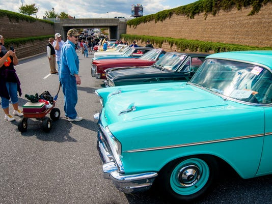 In this photo taken in October 2014, people gaze at collectible cars along the car corral during the Hershey Region Antique Automobile Club of America Fall Meet. The 2015 fall meet opens Wednesday.