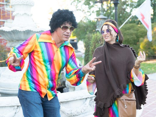 A couple dressed in 1960s attire dance during the Rock the Mansion festivities at the Warehime Myers Mansion on Oct. 10.
