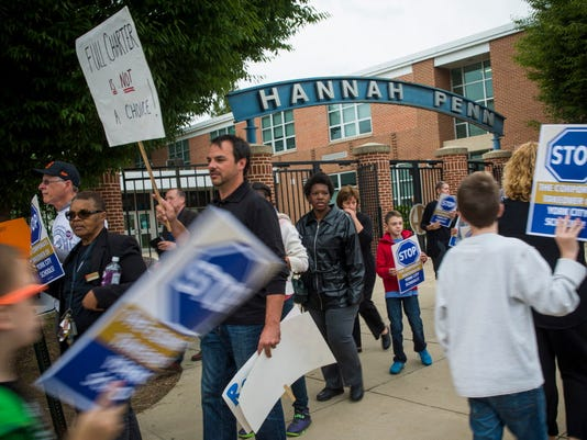 A large crowd of protesters including teachers, students, parents and community members assemble to demonstrate against a possible charter school takeover of the York City school district at Hannah Penn School on Wednesday, Sept. 24, 2014.