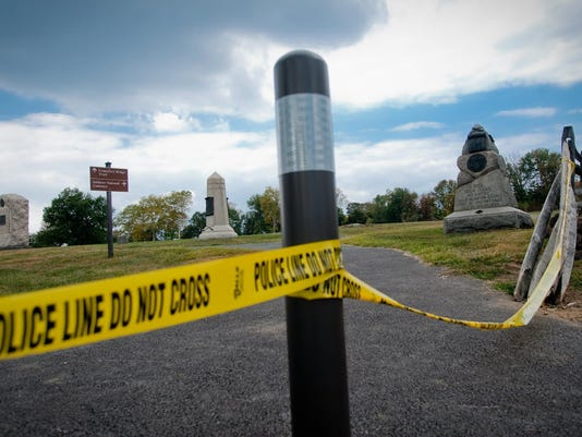 Battlefield monuments are seen behind a line of yellow police tape in Gettysburg National Military Park because of the government shutdown on Oct. 1. Pedestrian and vehicle access to almost all battlefield sites is restricted until further notice.