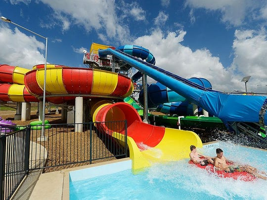 Patrons enjoy a water slide at another Wet 'n Wild in Sydney, Australia. The park in Orlando closes this week.
