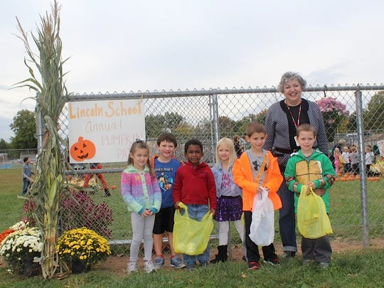 Students at Lincoln School in Westfield had fun at a Pumpkin Patch conducted at the school on Oct. 10. Each class participated in Fall themed activities and then selected pumpkins. Pictured is Lincoln School Principal Audrey Zavetz with (from left to right) Lauren Edwards, Luke Romano, Wilson Wright, Mary Cladis,Robbie Epstein and Chase Fiory. Schieferstein's Farm Market partnered with the school by supplying the pumpkins and other fall items.