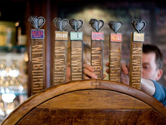 The Tap Tower with draft beer is shown at the Newburgh Brewing Company.