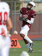 Aquinas's Kobe McNair catches a pass that turned into a 70-yard touchdown against Hilton last season. McNair earned first-team All-Greater Rochester honors in 2017.