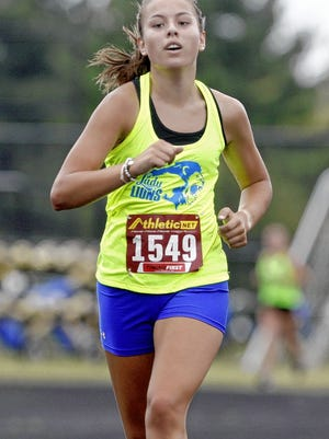 Junior Olivia Perry is among the top returnees for the Gahanna Lincoln girls cross country team and 15th-year coach Ernie Ziegler.