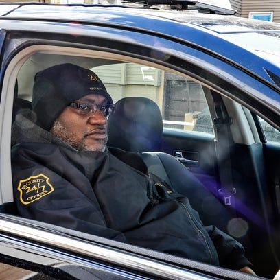 An armed security officer on patrol on Auburn Street,