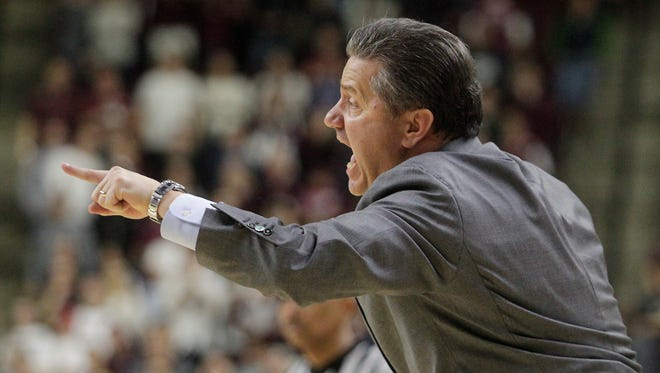 Kentucky's head coach John Calipari calls out plays during overtime of an NCAA college basketball game against Texas A&M, Saturday, Jan. 10, 2015, in College Station, Texas.  Kentucky won 70-64. (AP Photo/Patric Schneider)