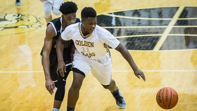 Monroe Central's Maurice Richardson chases down a ball against Burris at Lapel High School Tuesday, Feb. 28, 2017.