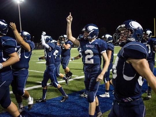 Marysville's Brett Robinson celebrates on the sidelines