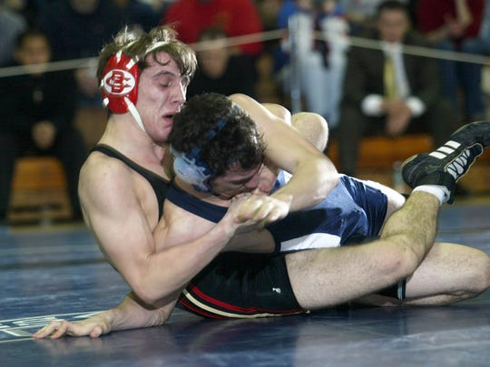 Bergen Catholic's Ben Duronio wraps up Seton Hall Prep's Phil Andolino during a 130-pound match in February 2005 in West Orange.