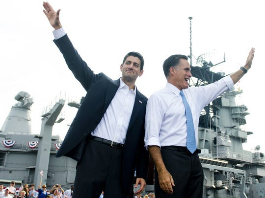 Former Massachusetts Gov. Mitt Romney announces Wisconsin Rep. Paul Ryan, right, as his vice presidential running mate during a campaign rally at the Nauticus Museum after touring the USS Wisconsin in Norfolk, Va., on Aug. 11, 2012.