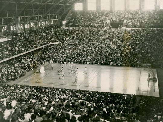 Fifteen thousand fans jammed Butler Fieldhouse in 1947 to watch Lawrence Central beat Manual 36-26 in the third day of the Indianapolis sectional tournament, March 1, 1947.
