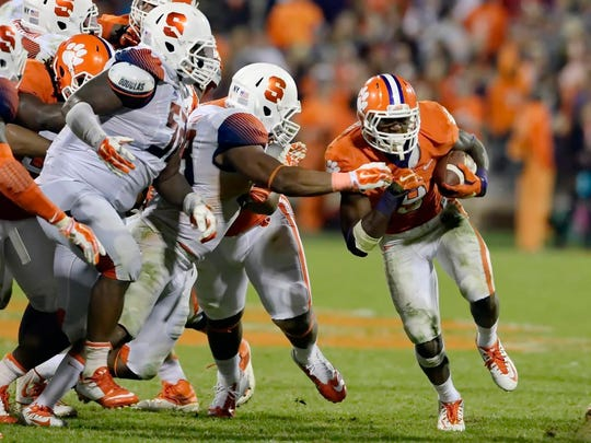 Clemson running back Wayne Gallman runs past the tackle attempt of Syracuse's Nick Robinson for a first down during the second half an NCAA college football game in Clemson, S.C.,  Saturday, Oct. 25, 2014. Clemson won 16-6. (AP Photo/ Richard Shiro)