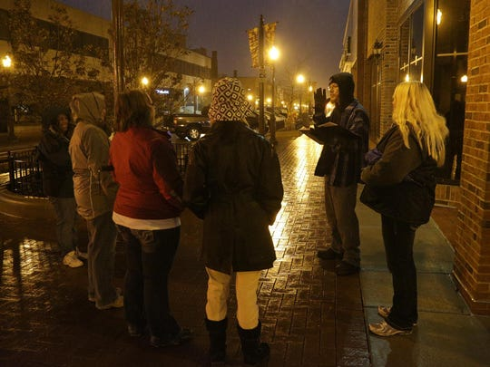 Terry Stevens leads a group during the Wausau Paranormal Research Society's annual Historic Downtown Wausau Fall Haunted Walking tours, Saturday, October 13, 2012, in downtown Wausau.