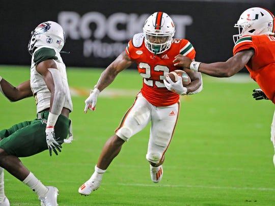 Miami running back Cam'Ron Harris (23) runs the ball in the third quarter against Alabama-Birmingham.