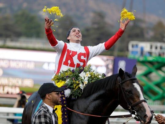 Irad Ortiz Jr. aboard Bricks and Mortar celebrates after winning the Breeders' Cup Turf horse race at Santa Anita Park, Saturday, Nov. 2, 2019, in Arcadia, Calif.(AP Photo/Gregory Bull)