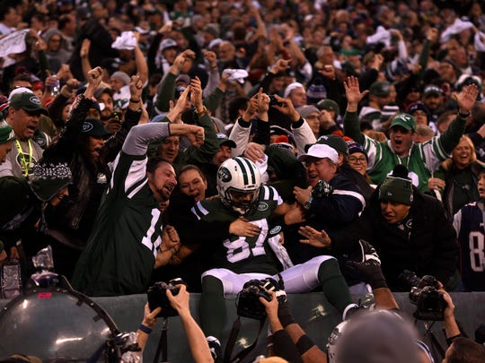 Eric Decker celebrating his game-winning touchdown catch in overtime after the Jets' 26-20 win over the Patriots in December.