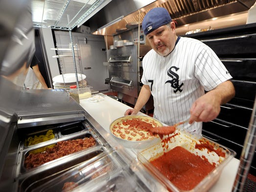 Bob Jaeger owner of South of Chicago Pizza and Beef makes a pizza in the kitchen, Wednesday, February 5, 2014, at 13578 E. 131st Street in Fishers.