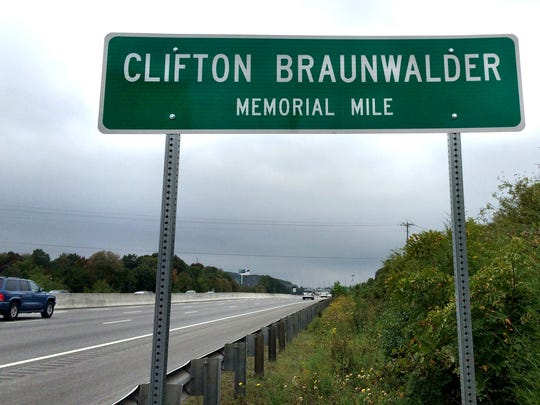 A sign in memory of Clifton Braunwalder stands at the