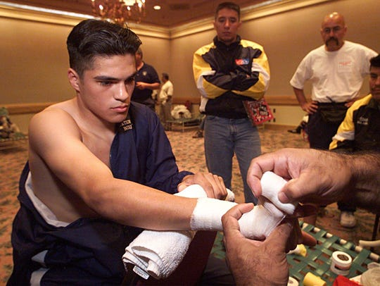 Jose Celaya gets his hands taped up in preparation