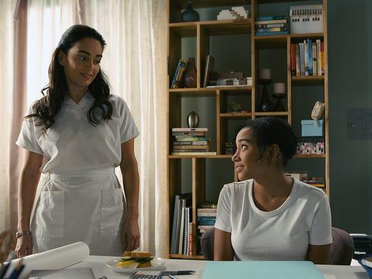 A nurse (Ana de la Reguera) accompanies Maddy (Amandla