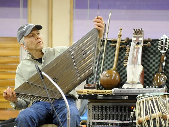 Multi-instrumentalist Todd Green performs on a santoor, similar to a hammered dulcimer.