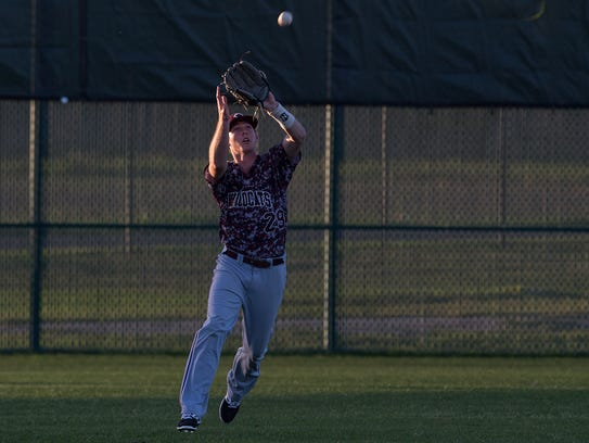 Calallen's Colten Duff catches a ball for an out during