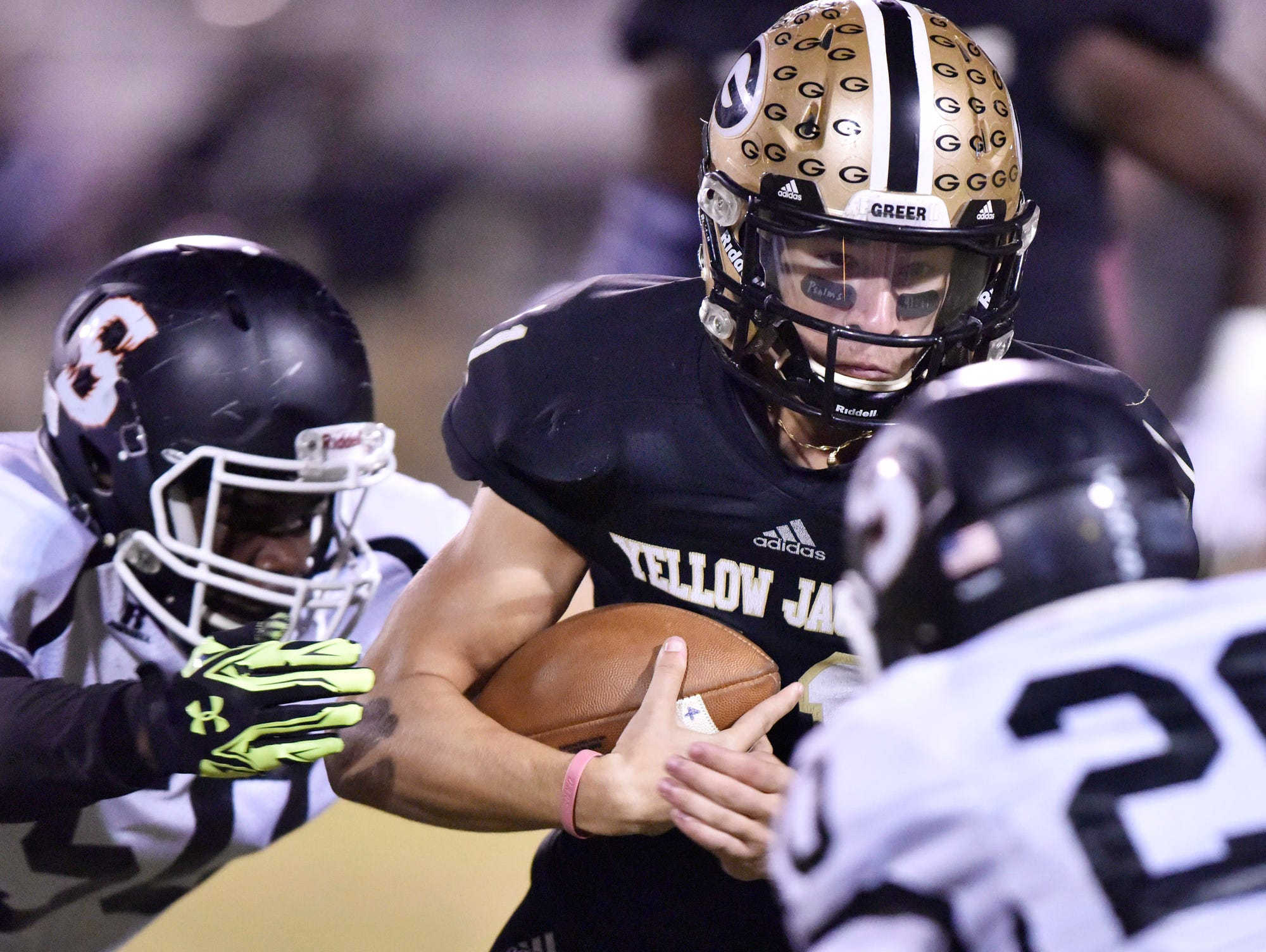 Greer quarterback Mario Cusano (11) is caught by Southside's Deshondre Mills (50).