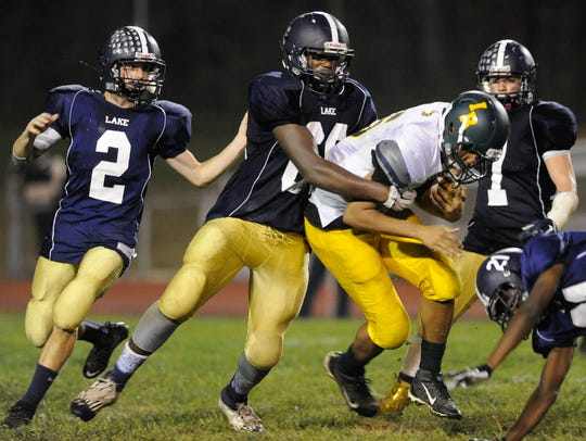 Lake Forest's #60 Dawaunta Parker tackles Indian River's