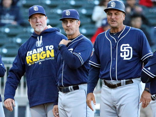 San Diego Padres hitting coach Alan Zinter, center, is introduced with fellow coaches and former major leaguers Mark McGwire, left, and Glenn Hoffman at a past exhibition game with the El Paso Chihuahuas at Southwest University Park.