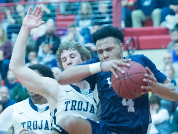 Pocono Mountain West's Lee Mosley (4) pulls a rebound