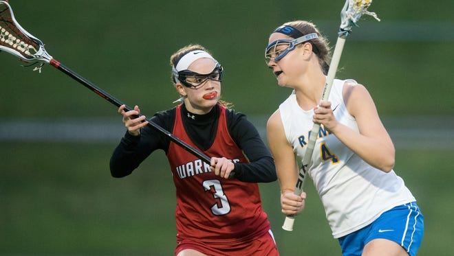 In this file photo, Kennard-Dale's Morgan Bowings (4) carries the ball on attack against Susquehannock's Riley Roeder (3) in a YAIAA girls' lacrosse game on Thursday, May 5, 2016. Kennard-Dale won, 17-6.
